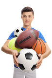Teenage athlete with different kinds of sports balls Stock Photo