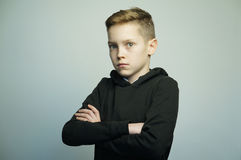 Teenage bad boy with stylish haircut, studio shot Royalty Free Stock Photo