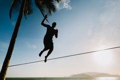 Teenage balancin on slackline with sky view Royalty Free Stock Image