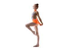 Teenage ballerina girl working out. Beautiful happy gymnast athlete teenage girl wearing dancer colorful leotard working out, dancing, posing, doing rhythmic royalty free stock photography