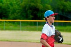 Teenage baseball player during a game. Stock Image