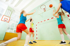 Teenage basketball players in action on the court Stock Photos