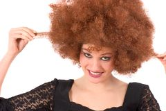 Teenage beauty having wig-fun Royalty Free Stock Photo