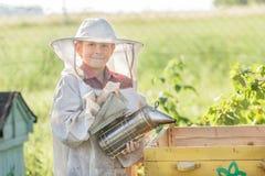 Teenage beekeeper wearing protective clothing Royalty Free Stock Photos