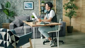 Teenage blogger reading in microphone creative podcast for internet blog. Teenage blogger handsome boy in trendy clothing is reading in microphone creative stock footage