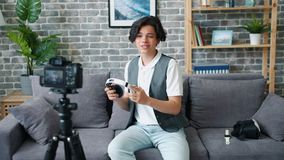 Teenage blogger recording video about modern headphones speaking about device. Teenage blogger is recording video about modern headphones speaking about device stock video