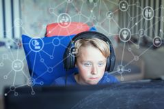 Teenage boy playing computer games on PC Royalty Free Stock Photos