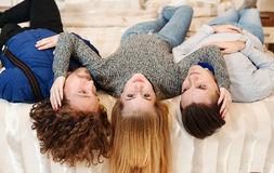 Young people on bed, close friends royalty free stock photos