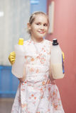 Teenage Blond Girl Holding Cleaning Tools Smiling Royalty Free Stock Images