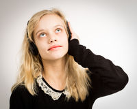 Teenage Blond Girl Listening To Her Headphones Royalty Free Stock Photography