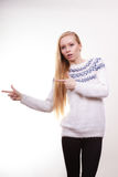 Teenage blonde woman pointing at copyspace Royalty Free Stock Photography