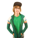 Teenage Boy. In jacket and ball cap with hands in pockets stock photos