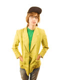 Teenage Boy. In jacket and ball cap with hands in pockets stock image