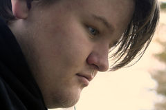 Teenage Boy 2. Profile closeup of a serious teenage boy royalty free stock photography