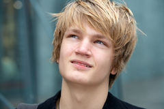 Teenage Boy. Close-up of teenage boy smiling in urban environment stock photo