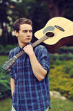 Teenage boy with acoustic guitar Stock Photography