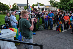 Teenage boy addresses crowd at Oregon vigil for Orlando shooting victims. Corvallis, OR, June 12 2016: Teenage boy addresses crowd at Oregon vigil for Orlando Royalty Free Stock Image