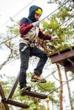 Teenage boy in an adventure park Stock Photos