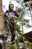 Teenage boy in an adventure park Royalty Free Stock Photo