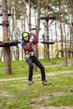 Teenage boy in an adventure park Stock Photography