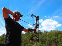 A boy practices archery at an outdoor range royalty free stock photos