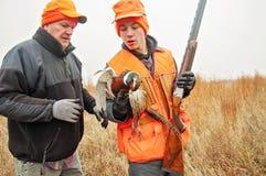 Free Teenage Boy And Man Pheasant Hunting Stock Photos - 64121773