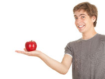 Teenage boy with apple Royalty Free Stock Photography