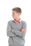 Teenage boy with arms crossed Stock Photo