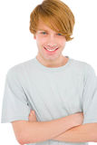 Teenage boy with arms folded Stock Photo