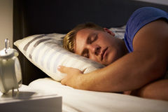 Teenage Boy Asleep In Bed At Night. Lying Down Stock Photography