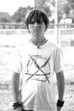 Teenage Boy with Attitude. Black and white image of a teenage boy with an attitude stock images