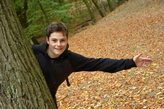 Teenage boy in autumn forest royalty free stock image