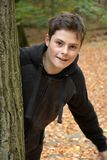 Teenage boy in autumn forest stock images