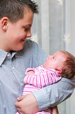 Teenage boy with baby sister. Teenage brother holding his baby girl sister in arms Royalty Free Stock Photos