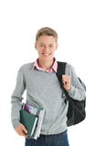Teenage boy with a backpack and school books Royalty Free Stock Photography