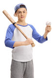 Teenage boy with a baseball and a bat. Looking at the camera isolated on white background Stock Photos