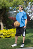 Teenage boy with basketball royalty free stock photo