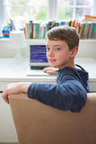 Teenage Boy In Bedroom Writing Computer Code Royalty Free Stock Photos