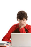 Teenage boy behind desk with laptop Royalty Free Stock Photos