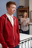 Teenage Boy Being Told Off By Mother Royalty Free Stock Photography
