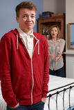 Teenage Boy Being Told Off By Mother Stock Photography