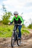 Teenage boy biking on forest trails Stock Photos