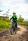 Teenage boy biking on forest trails Stock Photography