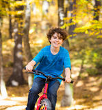 Teenage boy biking Royalty Free Stock Photos