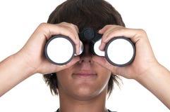 Teenage boy with binoculars. Om white backgraund Stock Photo