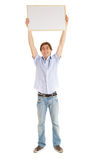 Teenage boy with blank sign Royalty Free Stock Images
