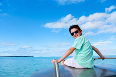 Teenage boy on a boat Stock Photography
