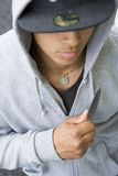Teenage Boy Branding Knife Royalty Free Stock Photography