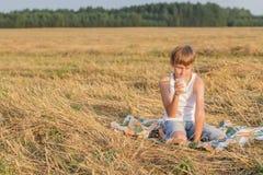 Teenage boy during break with glass of milk Stock Photo