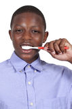 Teenage Boy Brushing Teeth Stock Photo